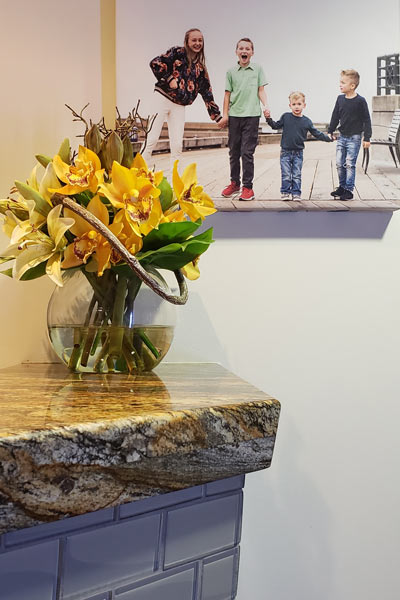 Flowers on the front desk and photo of children on the wall